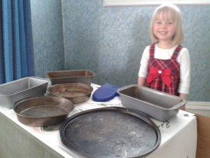 My sous-chef at her oven with all her pans, preparing a feast!